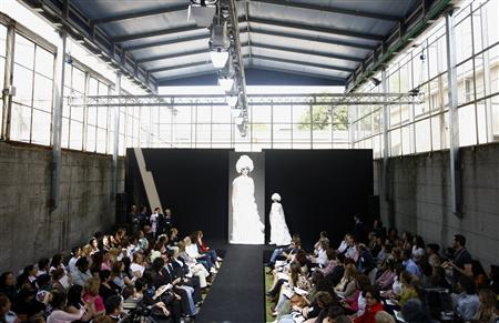 Female inmates at Milan's San Vittore prison launched their own womenswear line and a collection of white wedding dresses in the jail's courtyard